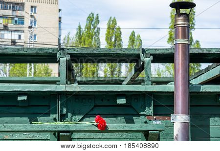 SARATOV RUSSIA - MAY 6 2017: Mobile Museum the Victory Train. Carnation flowers placed on wooden wagon of the Great Patriotic War.