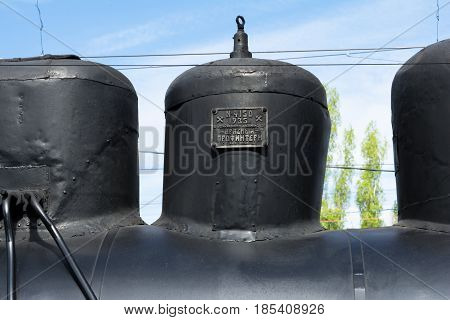 SARATOV RUSSIA - MAY 6 2017: the sign on the steam train. Text: No. 4150 1935 Bryansk engineering plant Red Profintern the village of Bezhitsa Western region. Fragment of old military locomotive.