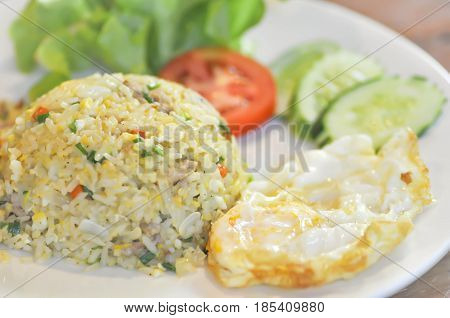 stir fried rice with fried egg and vegetable