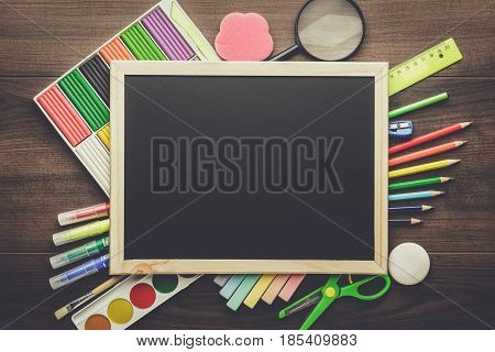 back to school concept. school supplies on the table. clean school blackboard with copy space. preschool and school essentials on the table.