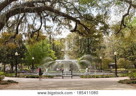 Savannah GA - March 27 2017: Forsyth Park is the largest park in Savannah's historic district and a famous tourist destination. The fountain dates to 1858 and is symbolic of Savannah.