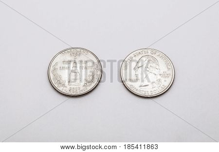 Closeup To Maryland State Symbol On Quarter Dollar Coin On White Background