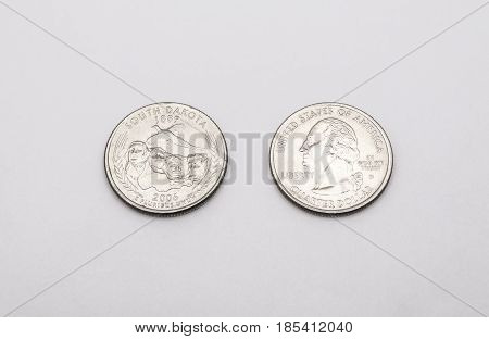 Closeup To South Dakota State Symbol On Quarter Dollar Coin On White Background