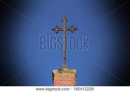Christian Metal Cross On Top Of A Clinker Church