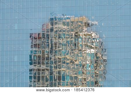One high building to reflect in another