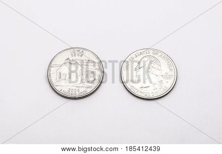 Closeup To Iowa State Symbol On Quarter Dollar Coin On White Background