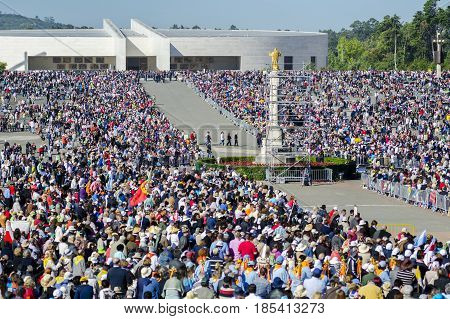 Fatima Portugal - May 13 2014: Pilgrims at the Sanctuary of Fatima during the celebrations of the apparition of the Virgin Mary in Fatima Portugal.
