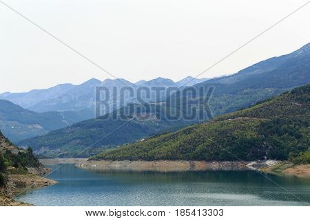 Landscape with mountains covered by pine forests descending to lake in Dim river area in Alanya of Turkey