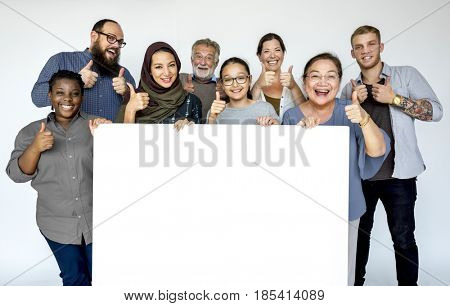 Group of diversity people with copyspace board advertising and thump up
