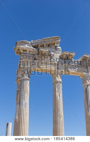Vertical shot of temple of Apollo against blue sky in ancient ruins of Side in Turkey