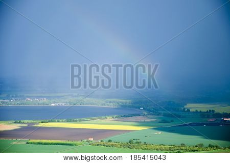 View of hilly landscape of Palava with forests rocks and lake Nove Mlyny in South Moravia under the sky with clouds in the rain