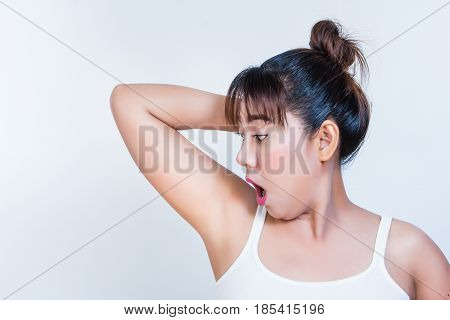 woman holding her arms up and showing and agape underarms