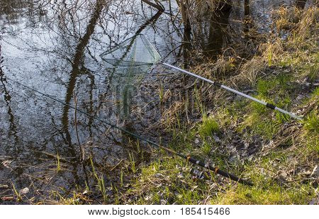 Fishing tackle and landing on the river bank