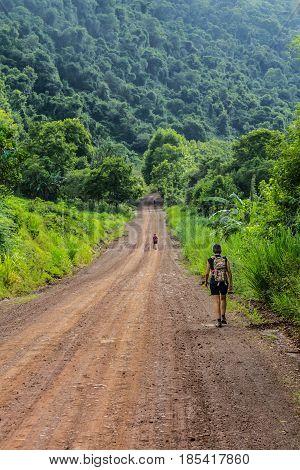 Trekking In Dirt Road