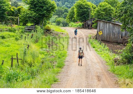 Trekking In Dirt Road
