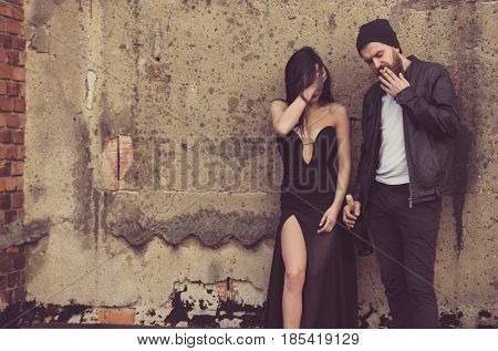 Sexy Girl And Bearded Man Smoking With Wine