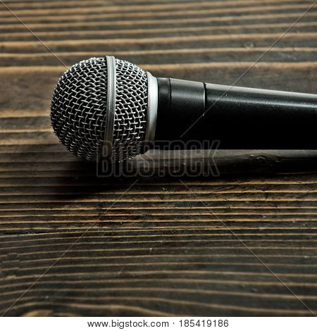 microphone. professional microphone on wooden background pub bar restaurant classic evening or night show copy space