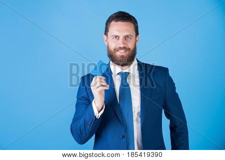 Man Smiling And Holding Credit Card On Blue Background