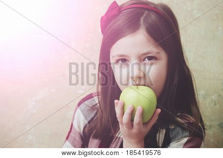 Pretty Girl Eating Vitamin Yellow Apple