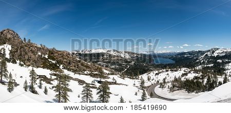 Truckee lake in snow covered Sierra Nevada mountains from Donner Pass and bridge