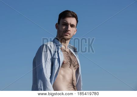 Handsome Man Posing In Unbutton Shirt With Hairy, Naked Torso