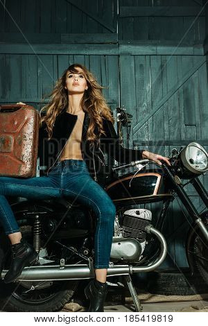 Biker Woman With Rusty Metallic Gas Can