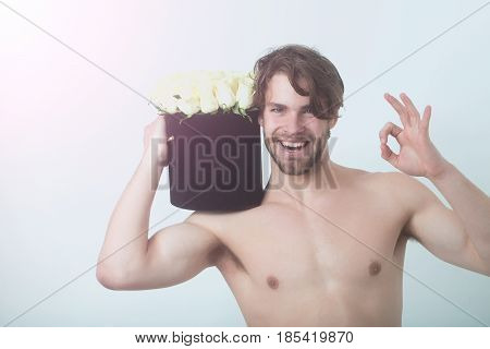 muscular sexy man with rose flower bouquet has strong naked torso isolated on white background handsome happy guy with undressed body copy space