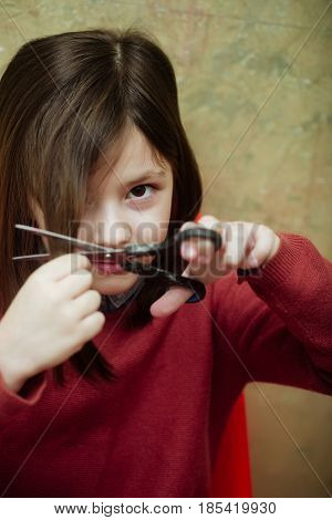 Kid Or Girl Cutting Hair With Scissors