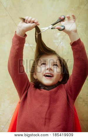 Child Or Girl, Hairdresser, Cutting Long Hair With Scissors Over Head