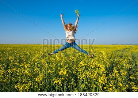 Joyful Young Woman, Blonde Jumping And Having Fun In A Field