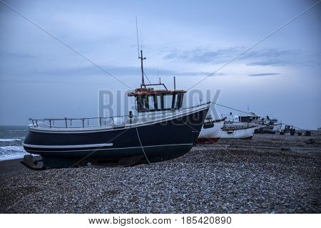 January 27, 2017 Lydd, East Sussex, England: Fishing boats on a shingle beach at Lydd-on-Sea in Romney Marsh, Kent