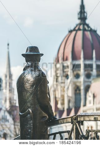 Bronze monument of Hungarian national hero Imre Nagy standing on bridge and looking towards Hungarian Parliament building in Budapest, Hungary on clear sunny day