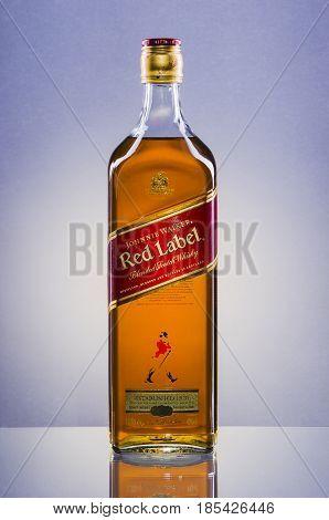 Johnnie Walker Red Label blended whisky on gradient background. Johnnie Walker was established in 1820 in Kilmarnock, Scotland.