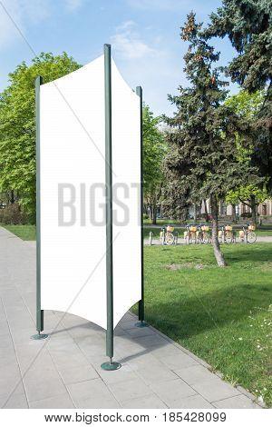 Advertising column mockup. Blank public information board mock up in the city