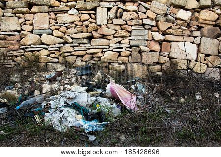 Rubbish dumped by the side of the road in the Maltese countryside.