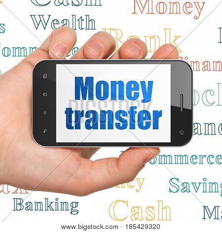 Money concept: Hand Holding Smartphone with  blue text Money Transfer on display,  Tag Cloud background, 3D rendering