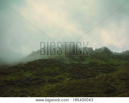 Swiss mountains in summer and the mystical fog
