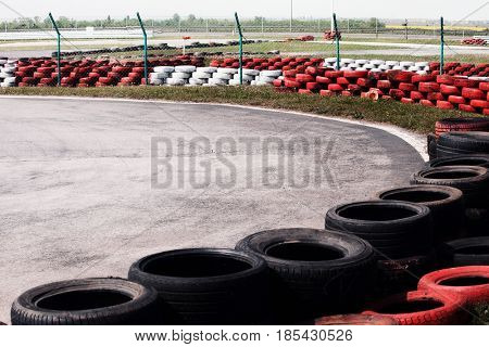 part of go kart track with tyres along sides
