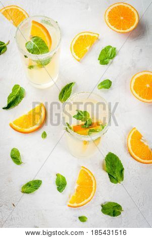 Summer Drink. Fresh Orange And Mint Lemonade With Ice In Glasses, Light Grey Stone Marble Table, Sel