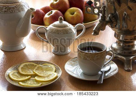 On the table is a tea set with a samovar