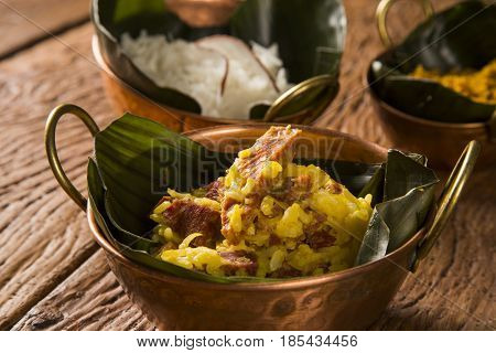 Rice With Coconut, Yellow Flour And  Dried Meat With Rice In An Old Copper Pot - Traditional Bahia F