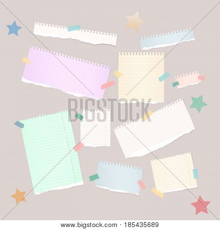 Ripped white , colorful note, notebook, copybook strips stuck with sticky tape and stars on light brown background.