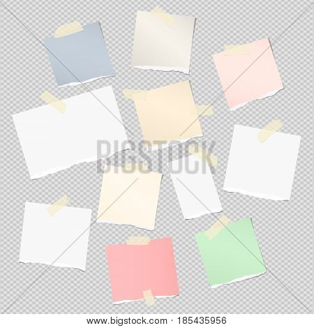 Ripped white , colorful note, notebook, copybook strips stuck with sticky tape on light gray background.