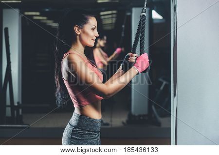 Slim, Bodybuilder Girl, Does The Exercises Standing In Front Of The Mirror In The Gym. Sports Concep