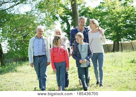 Happy intergenerational family walking in garden