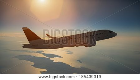 Airplane in flight over sea during sunset