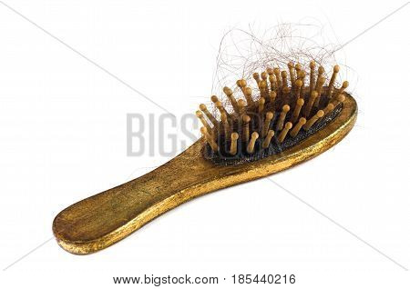Old golden comb with hairs isolated on the white background. Problem of losing hairs