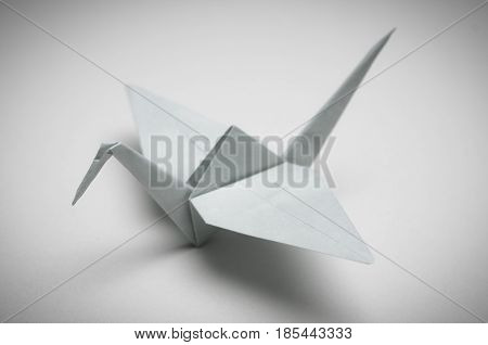 White Crane. Folded paper craft origami bird. Symbol of peace luck and happiness