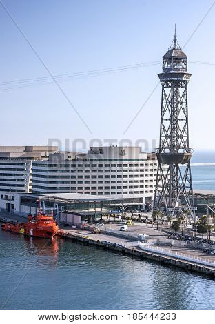 Barcelona, Spain - May 7, 2017: Seafront cruise sea port. Tower of teleferic de Montjuic