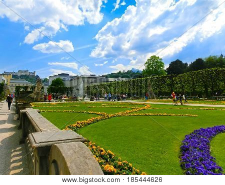 The beautiful Mirabell gardens in Salzburg. It is a popular destination visited by tourists at Salzburg, Austria